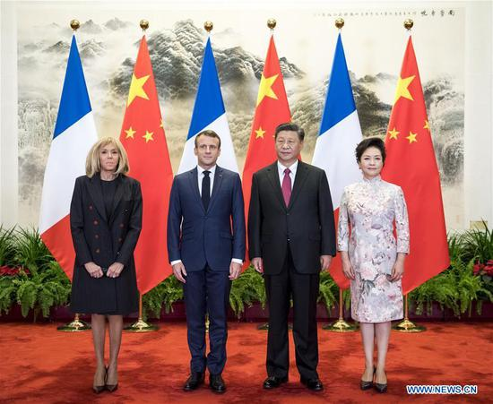 Chinese President Xi Jinping and his wife Peng Liyuan pose for photos with French President Emmanuel Macron and his wife Brigitte Macron ahead of talks between the two leaders in Beijing, capital of China, Nov. 6, 2019. (Xinhua/Li Xueren)