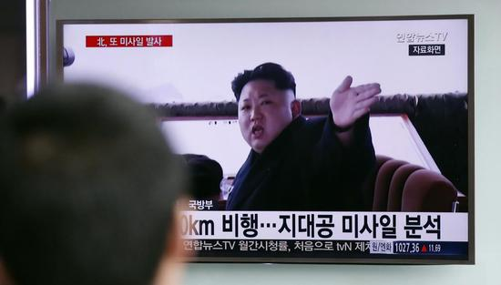 "A man watches a TV news program showing a file footage of North Korean leader Kim Jong Un at Seoul Railway Station in Seoul, South Korea, Friday, April 1, 2016. North Korea fired a short-range missile into the sea on Friday, Seoul officials said, hours after the U.S., South Korean and Japanese leaders warned the North it will face tougher sanctions if it continues with provocations. The Korean letters at bottom read: ""Analysis, the surface-to-air missile."" (AP Photo/Lee Jin-man)"