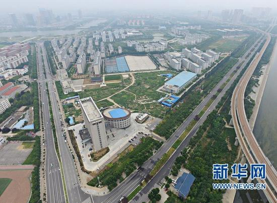 A new building at the Longzi Lake campus of the North China University of Water Resources and Electric Power in Zhengzhou City, Henan Province, has earned unwanted attention online as it appears to look like a toilet. The complex's front section resembles the toilet bowl and the back part, the cistern or tank. The building is yet to be occupied but there are plans for it to be a service center for university student start-ups in Henan. (Photo/Xinhua)