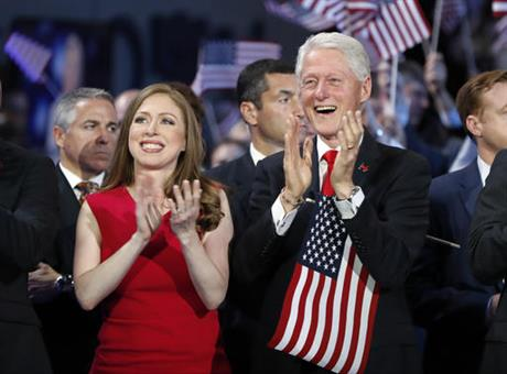 Chelsea Clinton and former President Bill Clinton applaud as Democratic presidential nominee Hillary Clinton speaks during the final day of the Democratic National Convention in Philadelphia, Thursday, July 28, 2016. (AP Photo/Carolyn Kaster)