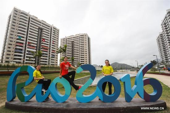 Members of the delegation of Egypt take a photo at the Olympic village in Rio de Janeiro, Brazil, on Aug. 2, 2016. With 31 buildings and 3,604 apartments, the village will host more than 17,000 athletes and officials during its peak times. Built in the neighbourhood of Recreio dos Bandeirantes in the west of Rio, it is close to Barra Olympic Park, the main venue cluster. (Xinhua/Zheng Huansong)