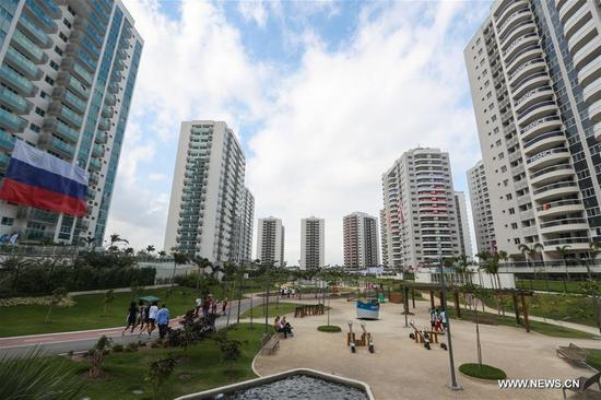 Photo taken on Aug. 2, 2016 shows the view of the Olympic village in Rio de Janeiro, Brazil. With 31 buildings and 3,604 apartments, the village will host more than 17,000 athletes and officials during its peak times. Built in the neighbourhood of Recreio dos Bandeirantes in the west of Rio, it is close to Barra Olympic Park, the main venue cluster. (Xinhua/Zheng Huansong)