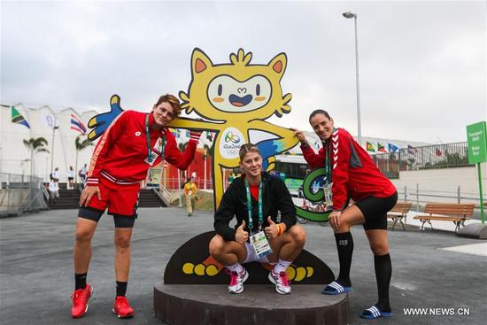 Members of the delegation of Montenegro take a photo at the Olympic village in Rio de Janeiro, Brazil, on Aug. 2, 2016. With 31 buildings and 3,604 apartments, the village will host more than 17,000 athletes and officials during its peak times. Built in the neighbourhood of Recreio dos Bandeirantes in the west of Rio, it is close to Barra Olympic Park, the main venue cluster. (Xinhua/Zheng Huansong)