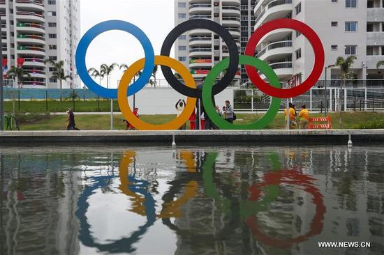 People take photos in front of a sculpture of Olympic at the Olympic village in Rio de Janeiro, Brazil, on Aug. 2, 2016. With 31 buildings and 3,604 apartments, the village will host more than 17,000 athletes and officials during its peak times. Built in the neighbourhood of Recreio dos Bandeirantes in the west of Rio, it is close to Barra Olympic Park, the main venue cluster. (Xinhua/Zheng Huansong)