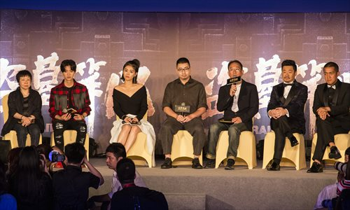 """The director and stars of the movie The Lost Tomb, including actor Lu Han (second from left), appear at a press conference on Wednesday in Shanghai to promote the film. The film's distributor is under a lot of pressure because it has signed """"a minimum box office guarantee"""" of 1 billion yuan ($15.01 million) with investors. Photo: CFP"""