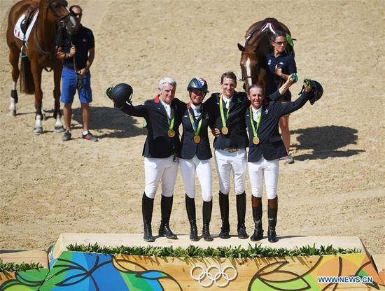 Players of France attend the awarding ceremony of the jumping team of equestrian at the 2016 Rio Olympic Games in Rio de Janeiro, Brazil, on Aug. 17, 2016. France won the gold medal. (Xinhua/Yan Yan)