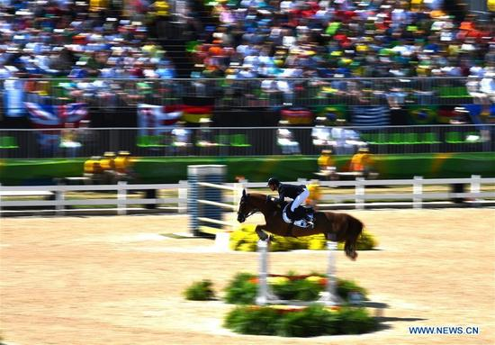 Kevin Staut of France competes during the jumping team of equestrian at the 2016 Rio Olympic Games in Rio de Janeiro, Brazil, on Aug. 17, 2016. France won the gold medal. (Xinhua/Liu Dawei)