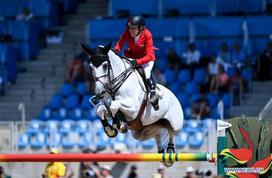 Germany's Ludger Beerbaum competes during the jumping team of Equestrian at the 2016 Rio Olympic Games in Rio de Janeiro, Brazil, on Aug. 17, 2016. Germany won the bronze medal. (Xinhua/Liu Dawei)