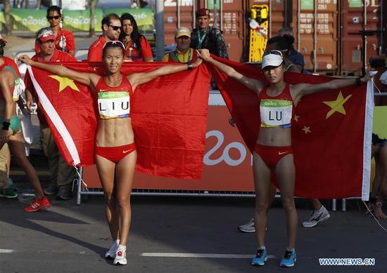 China's Liu Hong (L) and Lu Xiuzhi celebrate after the women's 20KM race walk at the 2016 Rio Olympic Games in Rio de Janeiro, Brazil, on Aug. 19, 2016. Liu Hong won the gold medal. (Xinhua/Wang Lili)