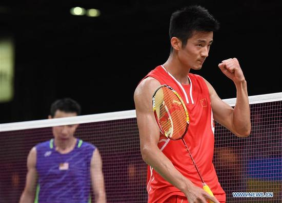 China's Chen Long celebrates scoring during the men's singles gold medal match of badminton between China's Chen Long and Malaysia's Lee Chong Wei at the 2016 Rio Olympic Games in Rio de Janeiro, Brazil, on Aug. 20, 2016. Chen took the title of the event after beating Lee 2-0. (Xinhua/Lui Siu Wai)