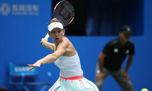 Simona Halep prepares a return against Yaroslava Shvedova during their third-round match at the 2016 WTA Wuhan Open on Wednesday in Wuhan, Central China's Hubei Province. Photo: CFP