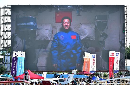 Photo taken on Nov. 1, 2016 shows a screen broadcasting Chinese astronaut Chen Dong sends his best wishes from the space lab Tiangong-2 to the on-going 11th China International Aviation and Aerospace Exhibition in Zhuhai, south China's Guangdong Province. The exhibition runs from Tuesday to Sunday in Zhuhai. (Xinhua/Liang Xu)