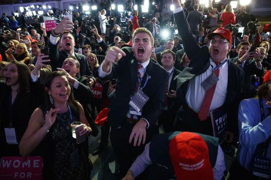 Trump supporters cheer his historic win