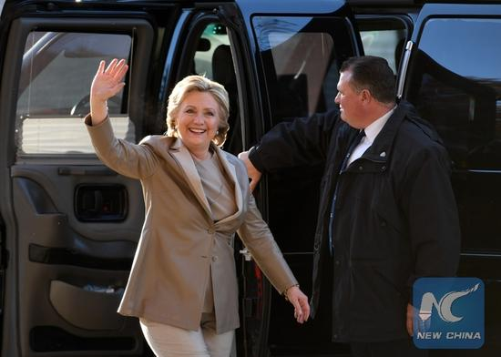 U.S. Democratic presidential candidate Hillary Clinton (L) arrives to cast her ballot at a polling station in Chappaqua, New York, the United States, on Nov. 8, 2016. The U.S. presidential elections kicked off on Tuesday. (Xinhua/Yin Bogu)