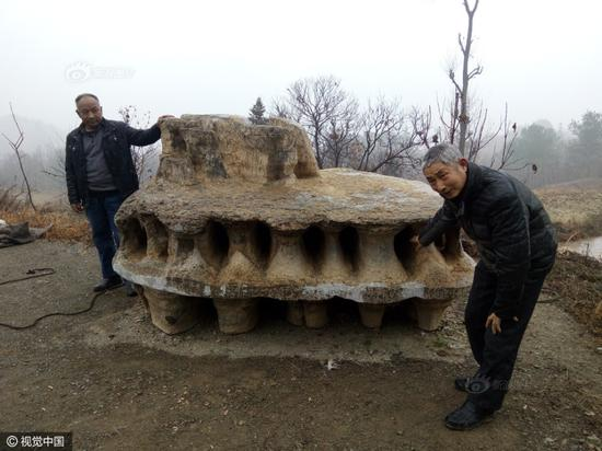 Xia Changjun, a villager at Baokang county, Xiangyang city of Hubei province, discovered a strange rock that looked similar to a flying disk. Someone offered 100,000 yuan (14,700 USD) for the stone, but Xia refused the proposal.