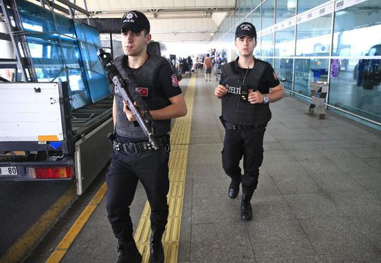Turkish police officers patrol outside Istanbul's Ataturk airport, Wednesday, June 29, 2016. Suicide attackers killed dozens and wounded scores of others at Istanbul's busy Ataturk Airport late Tuesday, the latest in a series of bombings to strike Turkey in recent months. Turkish authorities have banned distribution of images relating to the Ataturk airport attack within Turkey. (AP Photo/Lefteris Pitarakis) TURKEY OUT