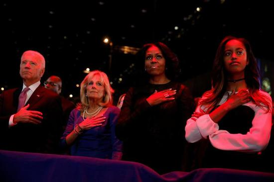 Barack Obama's wife Michelle (R2), daughter Malia attended the speech.