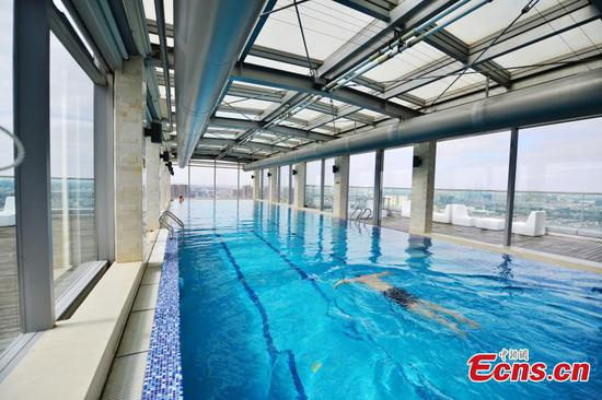 A swimming pool with one end suspended in the air at a hotel in Shanghai, Feb. 8, 2017. The swimming pool is 30 meters long, eight meters wide, and 1.5 meters deep. It's built on the 24th floor of a building, with a transparent section suspended in the air. It has been in use for nearly six years. (Photo: China News Service/Shen Chunchen)