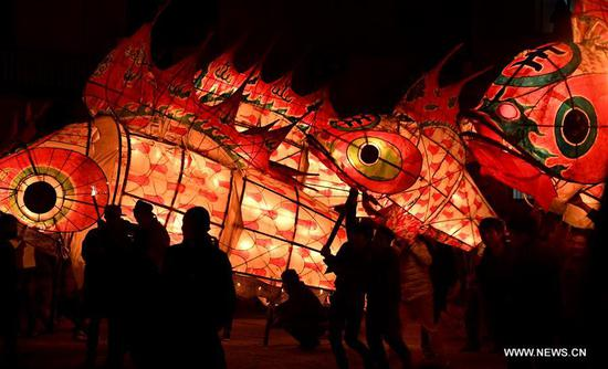 Villagers holding fish-shaped lanterns parade in Wangmantian Village of Shexian County, east China's Anhui Province, Feb. 9, 2017. The ritual believed to drive away the evil is performed annually from the 13th to 16th day of the Chinese Lunar New Year. (Xinhua/Tao Ming)