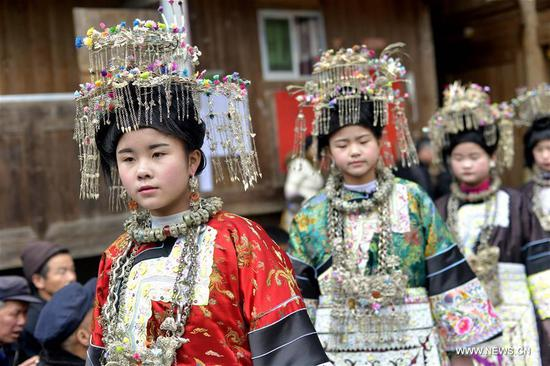 Women of Dong ethnic group wearing festival costumes gather at a party to celebrate the upcoming Lantern Festival in Renji Village of Rongjiang County, southwest China's Guizhou Province, Feb. 9, 2017. The Lantern Festival falls on Feb. 11 this year. (Xinhua/Wang Bingzhen)