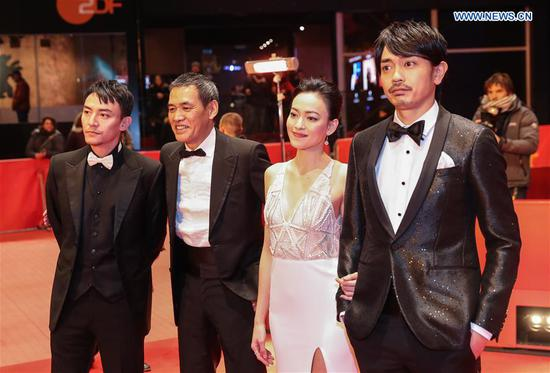 Director Sabu (2nd L), actor Chang Chen (1st L), actress Yao Yiti (2nd R) and actor Sho Aoyagi pose for photos on the red carpet for the premiere of film