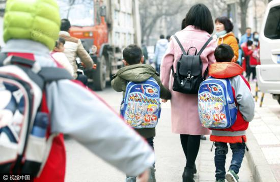 Parents accompany children to the school.
