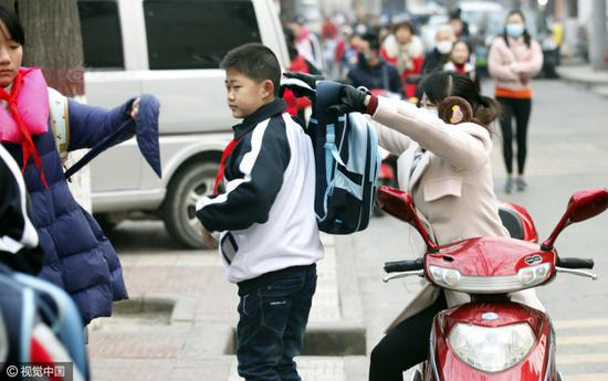 A mother accompanied her son to the school.