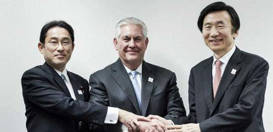 Japan's Foreign Minister Fumio Kishida (L), US Secretary of State Rex Tillerson (C) and South Korean Foreign Minister Yun Byung-se (R) shake hands before a meeting at the World Conference Centre in Bonn, Germany. (Brendan Smialowski/AFP)