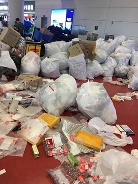 "Photos of messes in the Jeju airport were also released online. The newspaper said the garbage was mainly package materials such as paper box and plastic bags. The Chinese tourists got their free-duty goods at the counter and opened it and threw the package directly onto the ground. ""This seems to avoid customer's check since the commodities took smaller place without the package."""