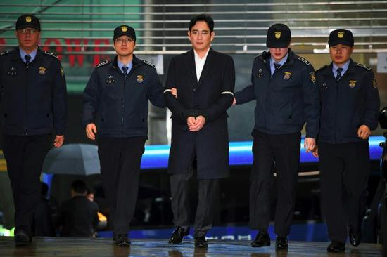 The indictment of Lee Jae-Yong (C), vice chairman of Samsung Electronics, casts new uncertainty over South Korea's biggest firm