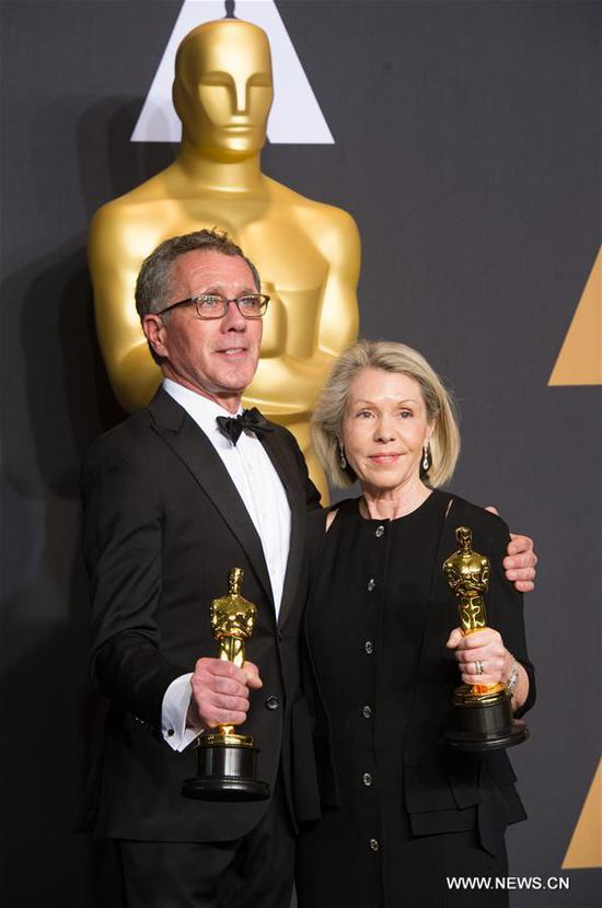 Production designer David Wasco (L) and art director Sandy Reynolds-Wasco pose after winning the Best Production Design award for