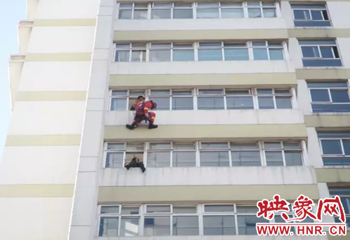 A woman was spotted sitting on a window of the ninth floor of a hospital with her legs dangling outside in Ruzhou city, Henan province on February 26, 2017.