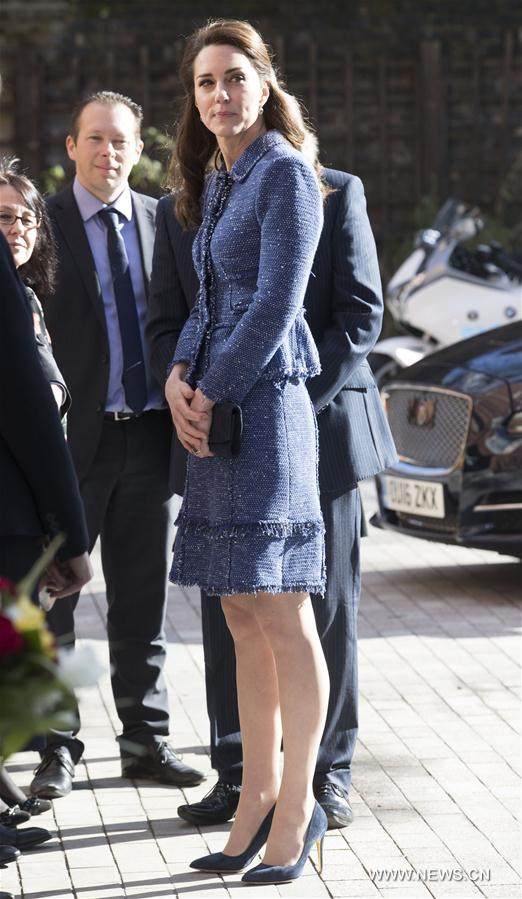Britain's Duchess of Cambridge Kate (Front) arrives at Ronald McDonald House Evelina London to officially mark the opening of the new