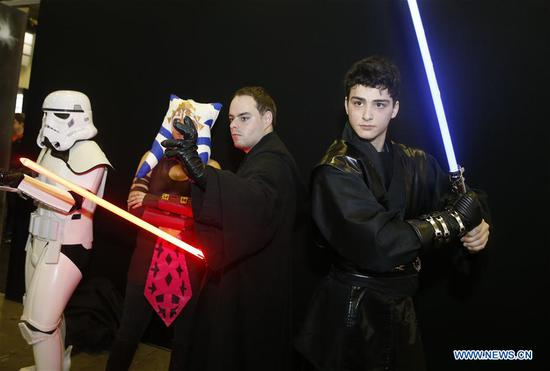 Cosplayers pose at Made in Asia animation and cartoon products fair in Brussels, Belgium, on March 5, 2017. (Xinhua/Ye Pingfan)