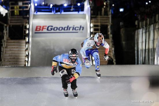 Competitors take part in the final stop of the Red Bull Crashed Ice series in Ottawa, Ontario, Canada, March 4, 2017. (Xinhua/David Kawai)