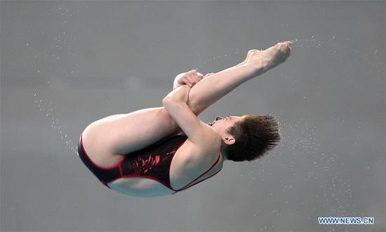 Si Yajie of China competes during the women's 10m platform final of the FINA Diving World Series 2017 in Beijing, capital of China, March 5, 2017. Si Yajie claimed the title of the event with a total of 406.60 points. (Xinhua/Wang Lili)
