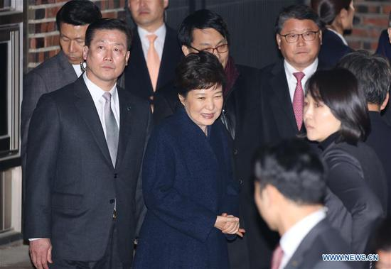 Ousted South Korean President Park Geun-hye (C) arrives at her private residence in Seoul on March 12, 2017. (Xinhua/Lee Sang-ho)