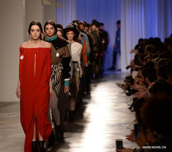 Models present creations of designer Dino Alves at the Lisbon Fashion Week Fall/Winter 2017/18 in Lisbon, capital of Portugal, on March 12, 2017. (Xinhua/Zhang Liyun)