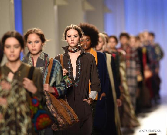 Models present creations of designer Christophe Sauvat at the Lisbon Fashion Week Fall/Winter 2017/18 in Lisbon, capital of Portugal, on March 12, 2017. (Xinhua/Zhang Liyun)
