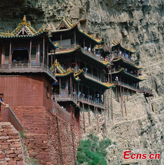 The Hanging Temple, also known as Xuankong Temple, is on a cliff near Mount Heng in Hunyuan County, Datong City, North China's Shanxi province. Built in 491, this temple is notable for its location on a sheer precipice, supported by crossbeams half-inserted into the rock as the foundation. It is also the only existing temple with the combination of three Chinese traditional religions: Buddhism, Taoism, and Confucianism. (Photo/CTPphoto)