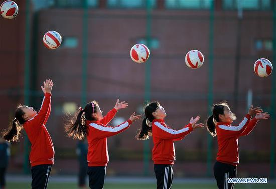 Girls of a soccer team in a primary school participate in a training in Yuquan District of Hohhot, capital of north China's Inner Mongolia Autonomous Region, March 15, 2017. (Xinhua/Ding Genhou)