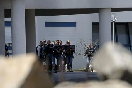 Police inside the Tocqueville high school after a shooting in Grasse, southern France, March 16, 2017. REUTERS/Eric Gaillard