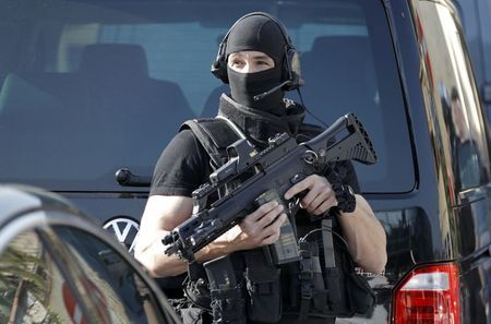 A member of special Police unit RAID outside the Tocqueville high school after a shooting in Grasse, southern France, March 16, 2017. REUTERS/Eric Gaillard