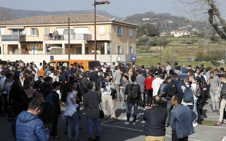 High school students stand near the Tocqueville high school after a shooting in Grasse, southern France, March 16, 2017. REUTERS/Eric Gaillard