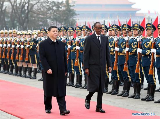 Chinese President Xi Jinping (L) holds a welcome ceremony for Rwanda President Paul Kagame before their talks in Beijing, capital of China, March 17, 2017. (Xinhua/Liu Weibing)