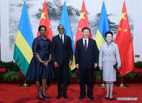 Chinese President Xi Jinping (2nd R) and his wife Peng Liyuan (1st R) pose for a photo with Rwanda President Paul Kagame (2nd L) and his wife in Beijing, capital of China, March 17, 2017. Xi held a welcome ceremony for Kagame's China visit before their talks on Friday. (Xinhua/Ju Peng)
