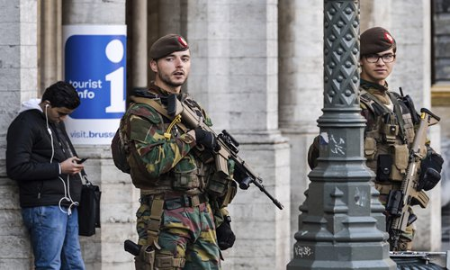 Belgian soldiers patrol the Grand Place in Brussels in December. After the March 22 terror attacks in Brussels, the city is still on high terror alert. Photo: IC