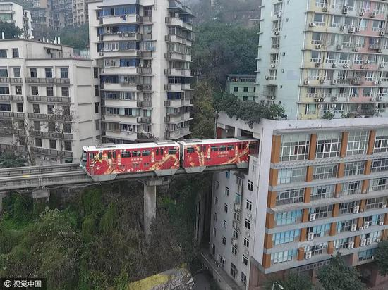 "Chongqing, China's ""city of mountains"", has its light-rail train drive through a residential building in Liziba Station due to its special landscape."