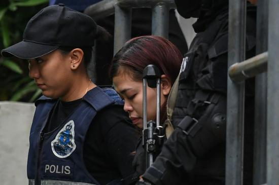 Indonesian Siti Aisyah (C) and Doan Thi Huong, from Vietnam, have been charged with his murder and have told investigators they were duped into believing they were participating in a TV prank show (AFP Photo/Mohd Rasfan)