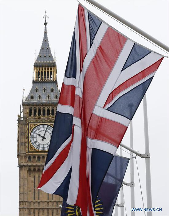 "Photo taken on March 14, 2017 shows the ""Big Ben"" and the UK flag in central London, Britain. The British upper house of the Parliament passed the Brexit Bill Monday night, clearing the last hurdle for the government to trigger Brexit. (Xinhua/Han Yan)"